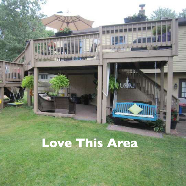 2 story deck, outdoor seating, under the deck, porch swing